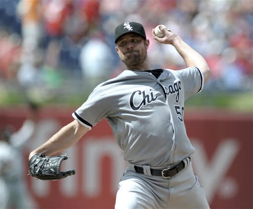 Chicago White Sox's John Danks delivers a pitch in the first inning during game one of a doubleheader interleague baseball game against the Philadelphia Phillies on Saturday, July 13, 2013, in Philadelphia. (AP Photo/Michael Perez)