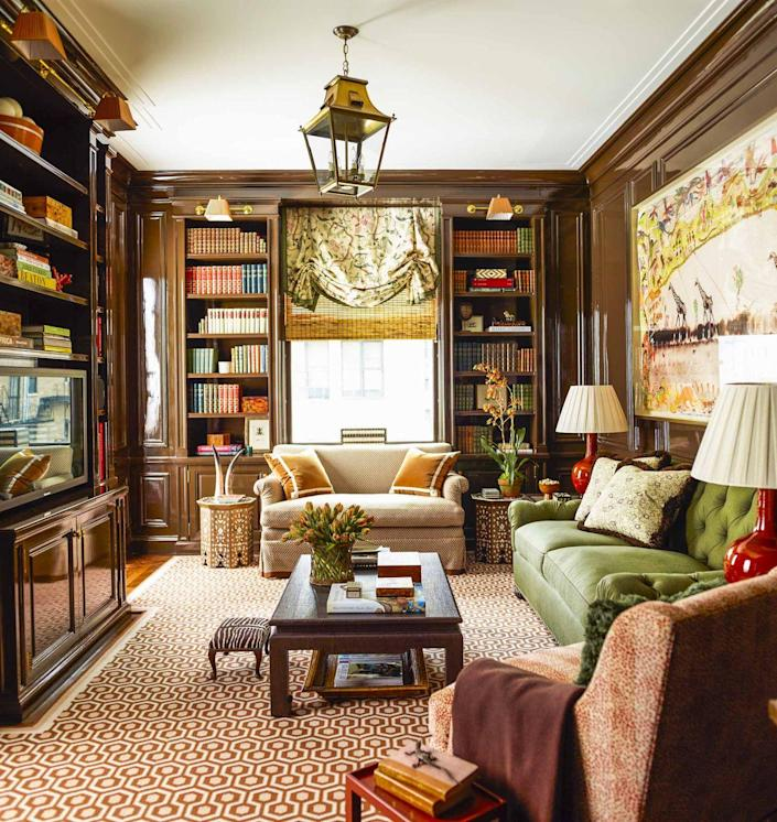"""<p>This New York home library, designed by decorator Ashley Whittaker, who worked for Roberts before going solo, features several hallmarks of the most beautiful chocolate brown rooms: brass accents, high-gloss finishes, animal motifs, and a David Hicks geometric carpet.</p><p><a class=""""link rapid-noclick-resp"""" href=""""https://www.sherwin-williams.com/homeowners/color/find-and-explore-colors/paint-colors-by-family/SW7027-wellbred-brown"""" rel=""""nofollow noopener"""" target=""""_blank"""" data-ylk=""""slk:Get the Look"""">Get the Look</a></p>"""