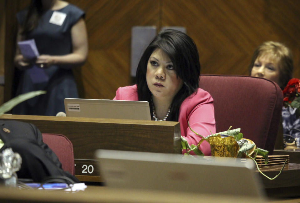 FILE - In this May 6, 2016, file photo, then-Republican Arizona state Sen. Kimberly Yee watches as a vote takes place at the Capitol in Phoenix. The state of Arizona has sold off $93 million in Unilever bonds and plans to sell the remaining $50 million it has invested in the global consumer products company because its subsidiary Ben & Jerry's decided to stop selling its ice cream in Israeli-occupied territories in the latest in a series of actions by states with anti-Israel boycott laws. The investment moves state Treasurer Yee announced tis week were mandated by a 2019 state law. (AP Photo/Bob Christie, File)