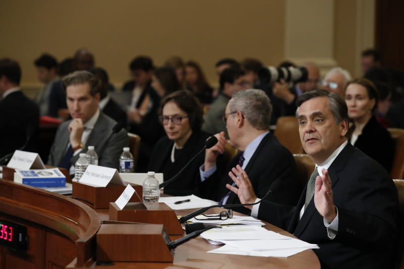 George Washington University Law School professor Jonathan Turley testifies during a hearing before the House Judiciary Committee on the constitutional grounds for the impeachment of President Donald Trump, on Capitol Hill in Washington, Wednesday, Dec. 4, 2019. From left,Harvard Law School professor Noah Feldman, Stanford Law School professor Pamela Karlan and University of North Carolina Law School professor Michael Gerhardt. (AP Photo/Alex Brandon)
