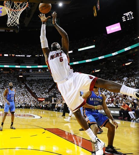 Miami Heat small forward LeBron James (6) shoots against the Oklahoma City Thunder during the first half at Game 3 of the NBA Finals basketball series, Sunday, June 17, 2012, in Miami. (AP Photo/Larry W. Smith, Pool)