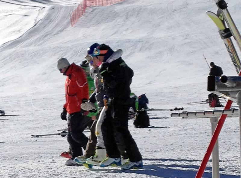 FILE - This Tuesday, Nov. 19, 2013, file image provided by Maris Van Slyke, which has been authenticated based on its contents and other AP reporting, reigning Olympic downhill champion Lindsey Vonn, center, is helped off the slope at Copper Mountain, Colo. Vonn crashed while training ahead of her return to racing following knee surgery. (AP Photo/Maris Van Slyke, File)