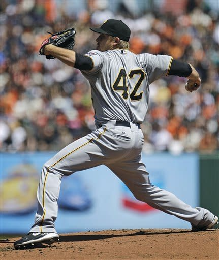 Pittsburgh Pirates' Kevin Correia works against the San Francisco Giants during the first inning of a baseball game Sunday, April 15, 2012, in San Francisco. (AP Photo/Ben Margot)