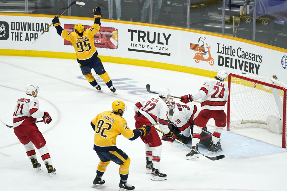 Nashville Predators center Matt Duchene (95) celebrates after scoring the winning goal against the Carolina Hurricanes during the second overtime in Game 3 of an NHL hockey Stanley Cup first-round playoff series Friday, May 21, 2021, in Nashville, Tenn. The Predators won 5-4. (AP Photo/Mark Humphrey)