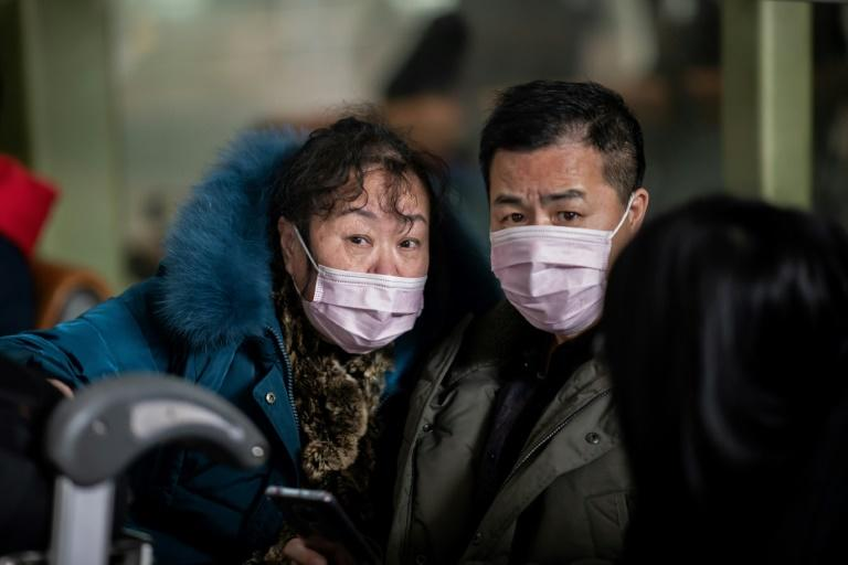 The emergence of the virus came at the worst time for China, coinciding with the Lunar New Year Holiday when hundreds of millions travel across the country in planes, trains and buses for family reunions (AFP Photo/NICOLAS ASFOURI)