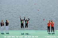 <p>Gold medalists Valentina Rodini and Federica Cesarini of Team Italy celebrate during the medal ceremony for the Lightweight Women's Double Sculls Final A on day six of the Tokyo 2020 Olympic Games at Sea Forest Waterway on July 29, 2021 in Tokyo, Japan. (Photo by Adam Pretty/Getty Images)</p>