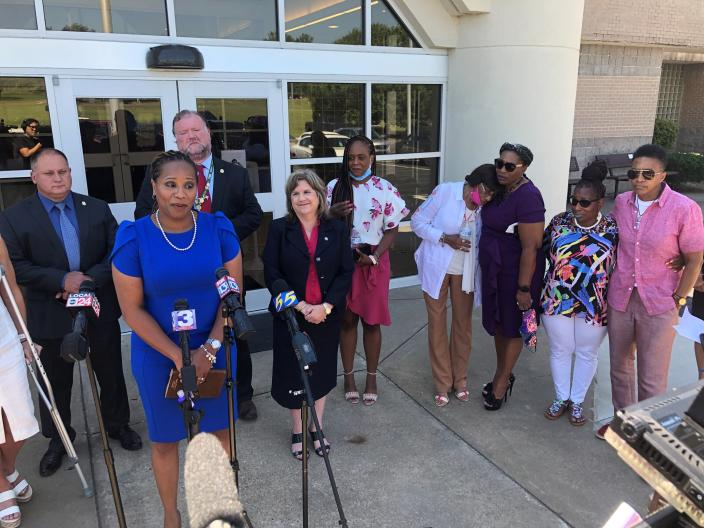 Shernaye Johnson (at microphone) talks to reporters after a Tennessee inmate was sentenced to life in prison in the death of her mother, Tennessee Department of Correction administrator Debra Johnson, on Monday, June 14, 2021, in Ripley, Tenn. Convicted felon Curtis Ray Watson pleaded no contest to first degree murder in perpetration of rape in the August 2019 killing of Johnson, who lived in a house on the grounds of the West Tennessee State Penitentiary. Prosecutors said Watson killed Johnson in her home before escaping the prison on a tractor. (AP Photo/Adrian Sainz)