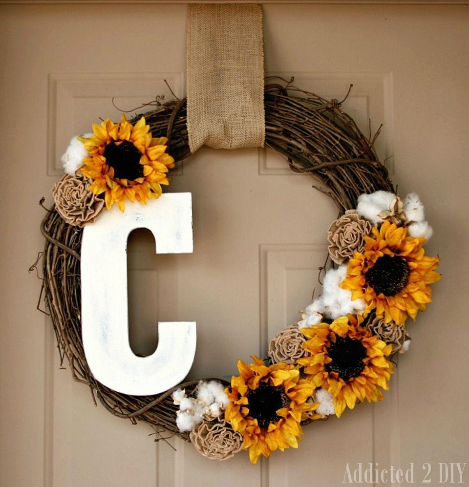 """<p>Get personal! Paint a wooden letter with a brightly colored hue and accent it with your favorite flowers, burlap rosettes, and cotton clusters on a grapevine wreath.</p><p><strong>Get the tutorial at <a href=""""http://addicted2diy.com/2014/08/26/fall-monogram-wreath/"""" rel=""""nofollow noopener"""" target=""""_blank"""" data-ylk=""""slk:Addicted 2 DIY"""" class=""""link rapid-noclick-resp"""">Addicted 2 DIY</a>.</strong></p>"""