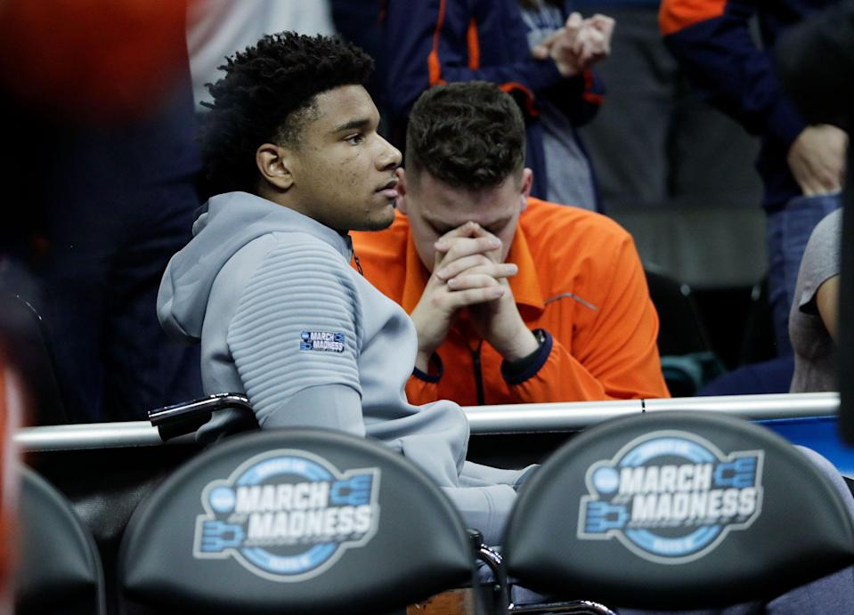 Injured Auburn forward Chuma Okeke sits behind the Auburn bench in a wheelchair during the second half of the Midwest Regional final game against Kentucky in the NCAA men's college basketball tournament Sunday, March 31, 2019, in Kansas City, Mo. Okeke was injured during Auburn's 97-80 win over North Carolina Friday. (AP Photo/Orlin Wagner)