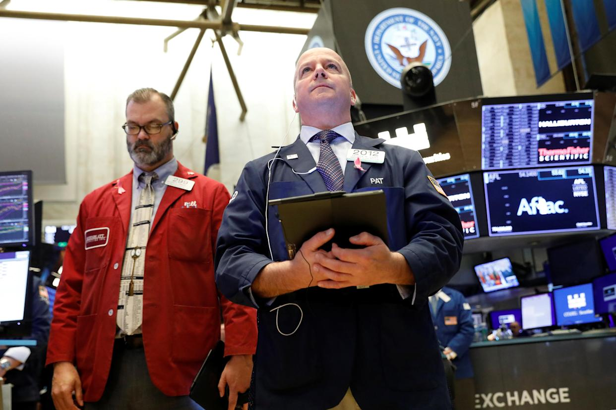 Traders on the floor at the New York Stock Exchange (NYSE) in New York. REUTERS/Brendan McDermid