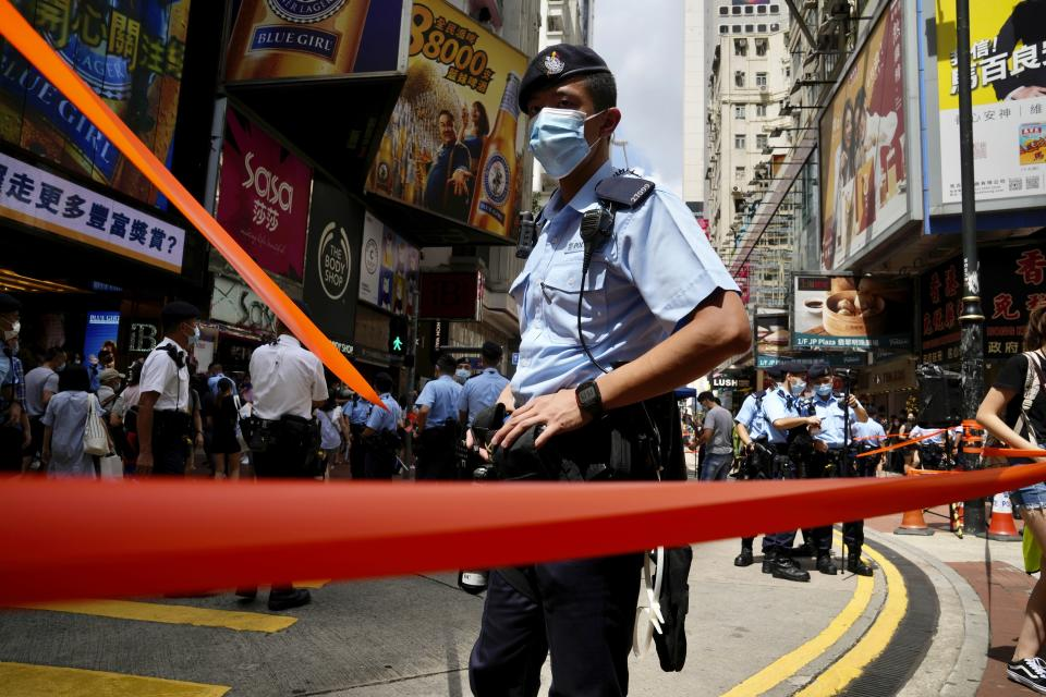 Police officers stand guard near Victoria Park, a past location for the annual protest rally marking the anniversary of the Hong Kong handover to China from Britain in Hong Kong, Thursday, July 1, 2021. (AP Photo/Kin Cheung)