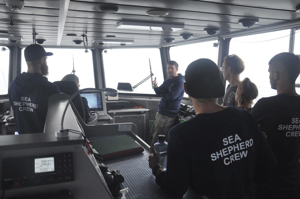 """Capt. Peter Hammarstedt, campaign director of Sea Shepherd, addresses the crew of the Ocean Warrior on July 13, 2021, during its 18-day high seas voyage to inspect the Chinese overseas fleet as it fishes for squid off the west coast of South America. Hammarstedt says, """"Beijing is exporting its overfishing problem to South America."""" (AP Photo/Joshua Goodman)"""