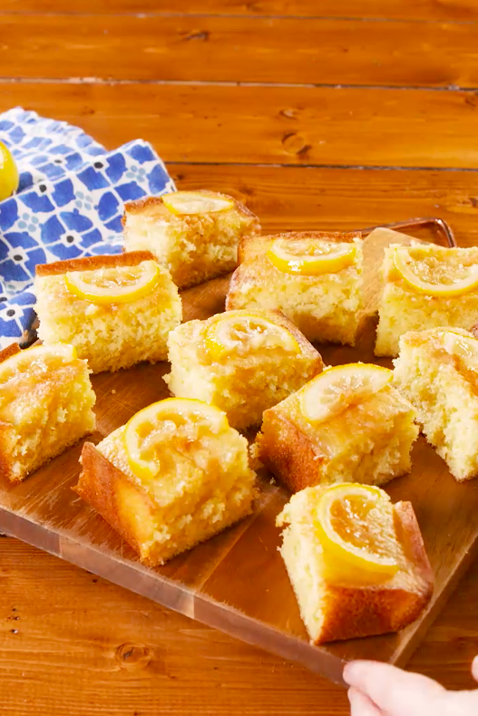 """<p>This lemon drizzle <a href=""""https://www.delish.com/uk/cooking/recipes/a28830505/salted-caramel-sheet-cake-recipe/"""" rel=""""nofollow noopener"""" target=""""_blank"""" data-ylk=""""slk:traybake"""" class=""""link rapid-noclick-resp"""">traybake</a> is a great alternative to the traditional loaf or round cake recipe. Easily cut into slices, it's perfect to serve with <a href=""""https://www.delish.com/uk/cooking/recipes/g28934063/afternoon-tea-recipes/"""" rel=""""nofollow noopener"""" target=""""_blank"""" data-ylk=""""slk:afternoon tea"""" class=""""link rapid-noclick-resp"""">afternoon tea</a>, a <a href=""""https://www.delish.com/uk/cooking/recipes/g28841964/bake-sale/"""" rel=""""nofollow noopener"""" target=""""_blank"""" data-ylk=""""slk:bake sale"""" class=""""link rapid-noclick-resp"""">bake sale</a>, or pre-cutting for a <a href=""""https://www.delish.com/uk/cooking/recipes/g28783985/baking-with-kids/"""" rel=""""nofollow noopener"""" target=""""_blank"""" data-ylk=""""slk:kid's birthday party"""" class=""""link rapid-noclick-resp"""">kid's birthday party</a>. </p><p>Get the <a href=""""https://www.delish.com/uk/cooking/recipes/a30543470/lemon-drizzle-traybake/"""" rel=""""nofollow noopener"""" target=""""_blank"""" data-ylk=""""slk:Lemon Drizzle Traybake"""" class=""""link rapid-noclick-resp"""">Lemon Drizzle Traybake</a> recipe.</p>"""