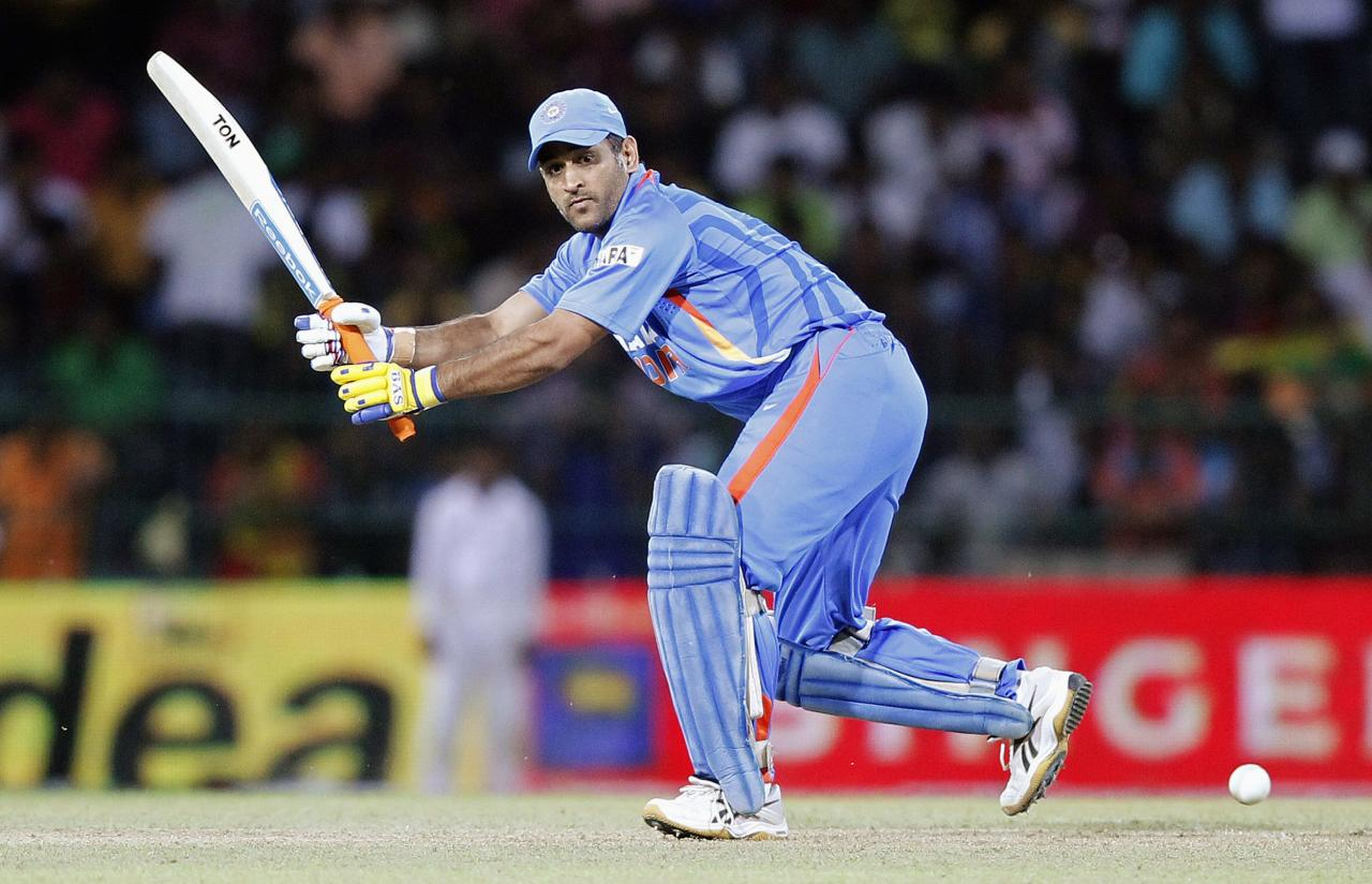 India's captain Mahendra Singh Dhoni plays a shot during the third One-Day International cricket match against Sri Lanka in Colombo, July 28, 2012. REUTERS/Dinuka Liyanawatte (SRI LANKA - Tags: SPORT CRICKET)