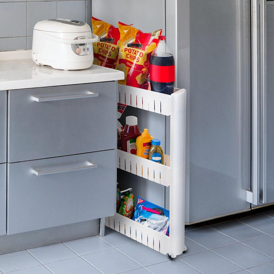 <p>Fill that awkward open space in your kitchen with this <span>Everyday Home Portable Shelving Unit Organizer</span> ($25).</p>