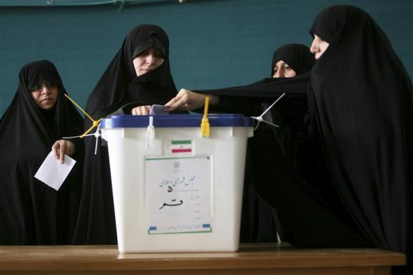 Women cast their votes during the parliamentary election, in the court yard of the holy shrine in Qom, south of Tehran March 2, 2012.