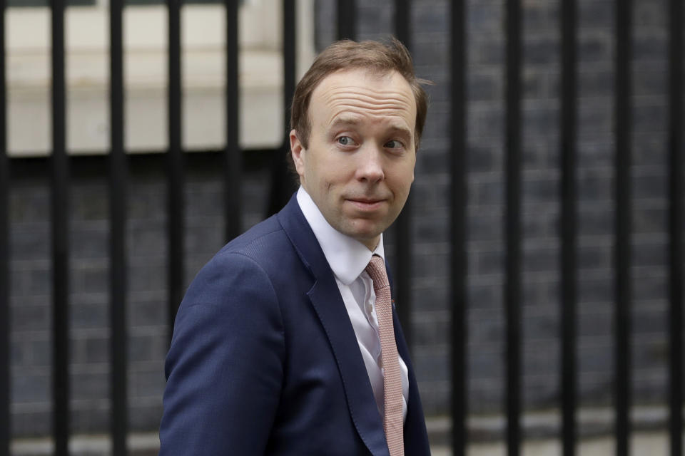 British Health Secretary Matt Hancock leaves 10 Downing Street in London, Thursday, April 30, 2020. The highly contagious COVID-19 coronavirus has impacted on nations around the globe, many imposing self isolation and exercising social distancing when people move from their homes. (AP Photo/Matt Dunham)