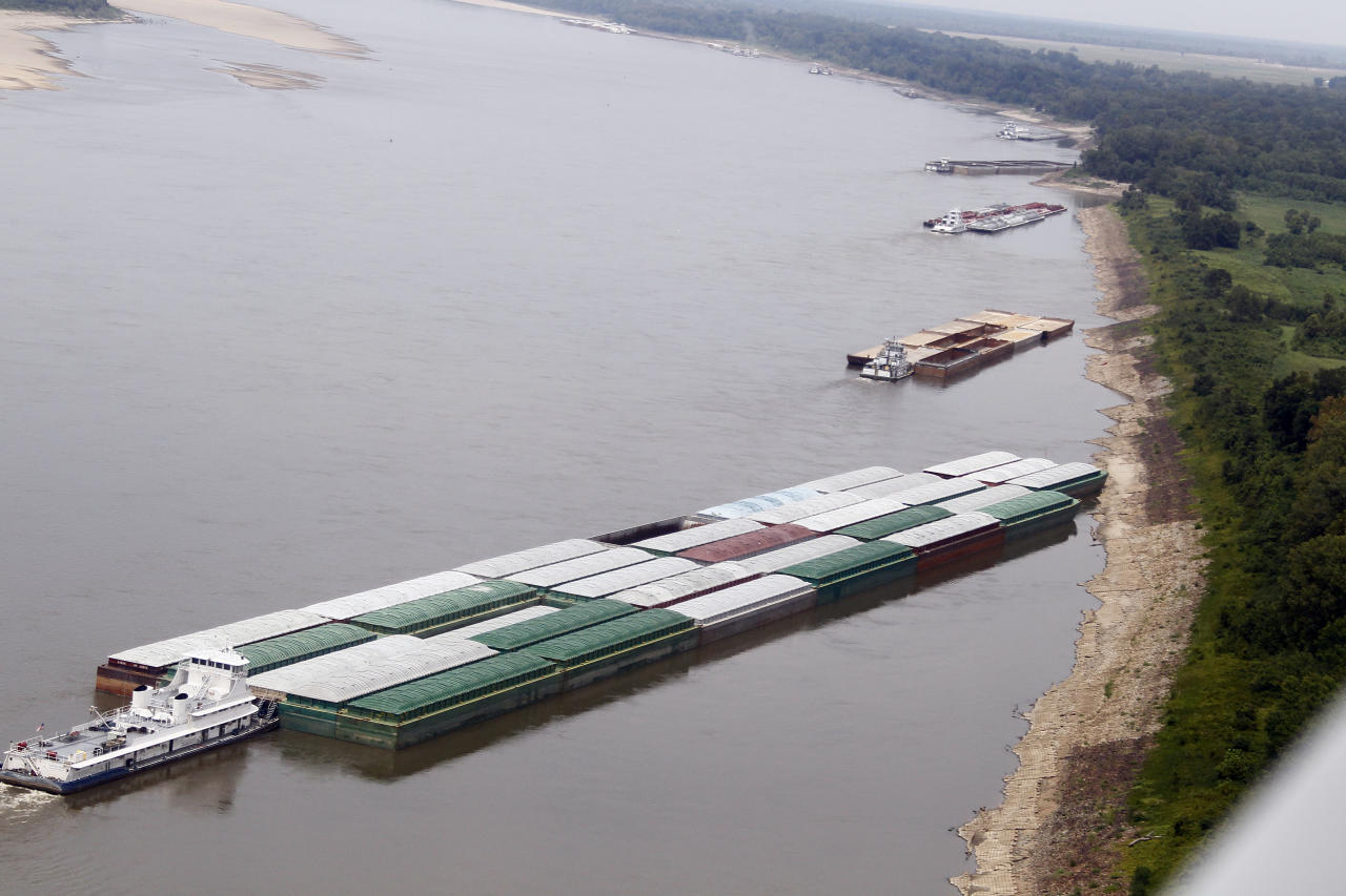 Barges and their towboats accumulate alongside the Mississippi banks of the Mississippi River near Greenville, Miss., Tuesday, Aug. 21, 2012. Officials with the U.S. Army Corps of Engineers say low water levels that are restricting shipping traffic, forcing harbor closures and causing towboats and barges to run aground on the Mississippi River are expected to continue into October. (AP Photo/Rogelio V. Solis)