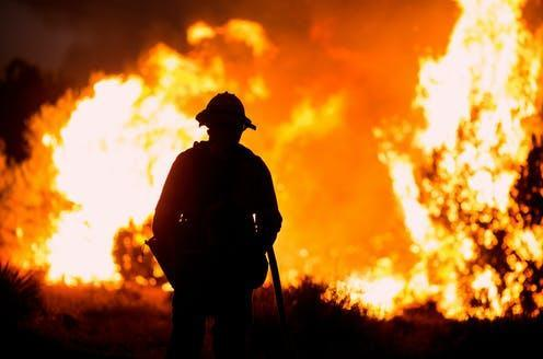 """<span class=""""caption"""">Wild fires on the US's West Coast displaced many from their homes, making them climate change migrants. </span> <span class=""""attribution""""><a class=""""link rapid-noclick-resp"""" href=""""https://www.shutterstock.com/image-photo/firefighter-watches-bobcat-fire-burns-juniper-1818129098"""" rel=""""nofollow noopener"""" target=""""_blank"""" data-ylk=""""slk:Ringo Chiu/Shutterstock"""">Ringo Chiu/Shutterstock</a></span>"""