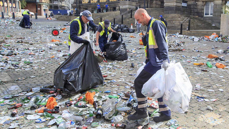 Workers, pictured here clearing rubbish from the centre of Leeds.