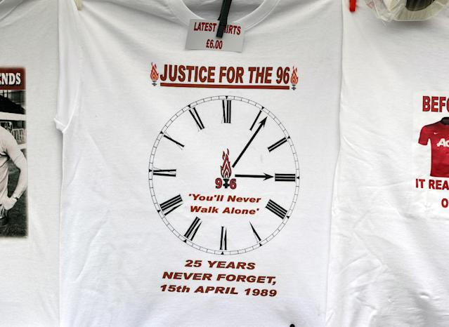 T-shirts on sale outside Anfield to mark the 25th anniversary of the Hillsborough disaster, before the English Premier League soccer match between Liverpool and Manchester City at Anfield in Liverpool, England, Sunday April. 13, 2014. (AP Photo/Clint Hughes)