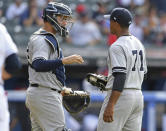 New York Yankees relief pitcher Stephen Tarpley, right, is congratulated by catcher Gary Sanchez after defeating the Cleveland Indians 7-6 in a baseball game, Sunday, June 9, 2019, in Cleveland. (AP Photo/David Dermer)