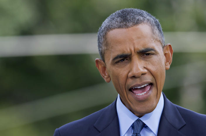 President Barack Obama announces new economic sanctions against key sectors of the Russian economy on the South Lawn of the White House in Washington in July 2014. (Photo: Manuel Balce Ceneta/AP)