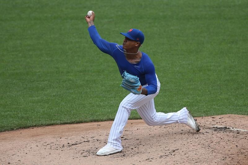 Marcus Stroman tosses pitch to home plate at Citi Field