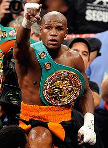 Floyd Mayweather Jr. took the welterweight title from Victor Ortiz with an easy fourth-round knockout