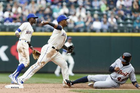 May 20, 2018; Seattle, WA, USA; Seattle Mariners shortstop Jean Segura (2) turns a double play against Detroit Tigers shortstop Dixon Machado (49) during the tenth inning at Safeco Field. Mandatory Credit: Joe Nicholson-USA TODAY Sports