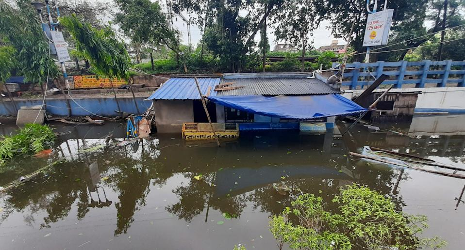 Floodwater nearly drowned entire homes in West Bengal, India on May 21. Source: AAP