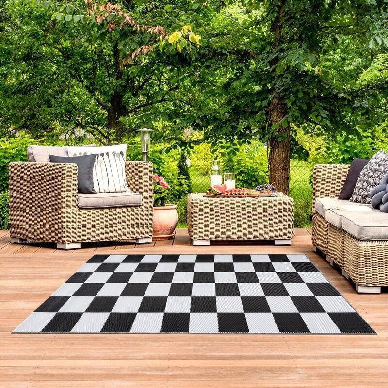 "<br><br><strong>Corrigan Studio</strong> Checkered Black/White Indoor / Outdoor Area Rug, $, available at <a href=""https://go.skimresources.com/?id=30283X879131&url=https%3A%2F%2Fwww.wayfair.com%2Frugs%2Fpdp%2Fcorrigan-studio-checkered-blackwhite-indoor-outdoor-area-rug-w004189332.html"" rel=""nofollow noopener"" target=""_blank"" data-ylk=""slk:Wayfair"" class=""link rapid-noclick-resp"">Wayfair</a>"