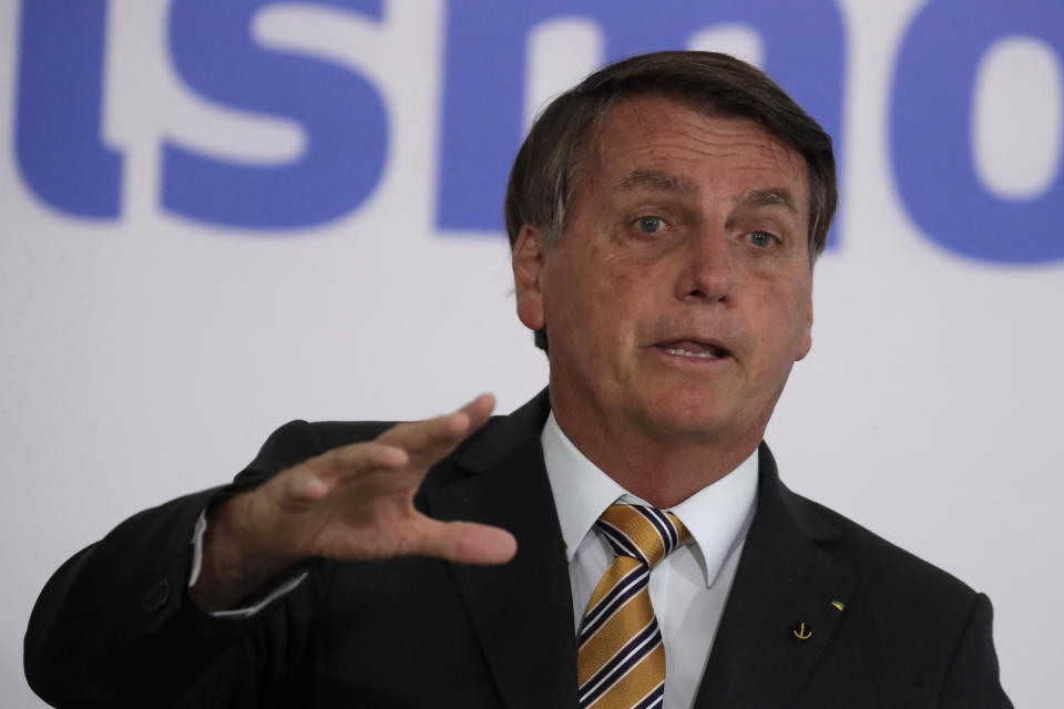 Brazil's President Jair Bolsonaro speaks during a ceremony presenting a program to restart tourism, amid the COVID-19 pandemic, at Planalto Palace in Brasilia, Brazil, Tuesday, Nov. 11, 2020. (AP Photo/Eraldo Peres)w