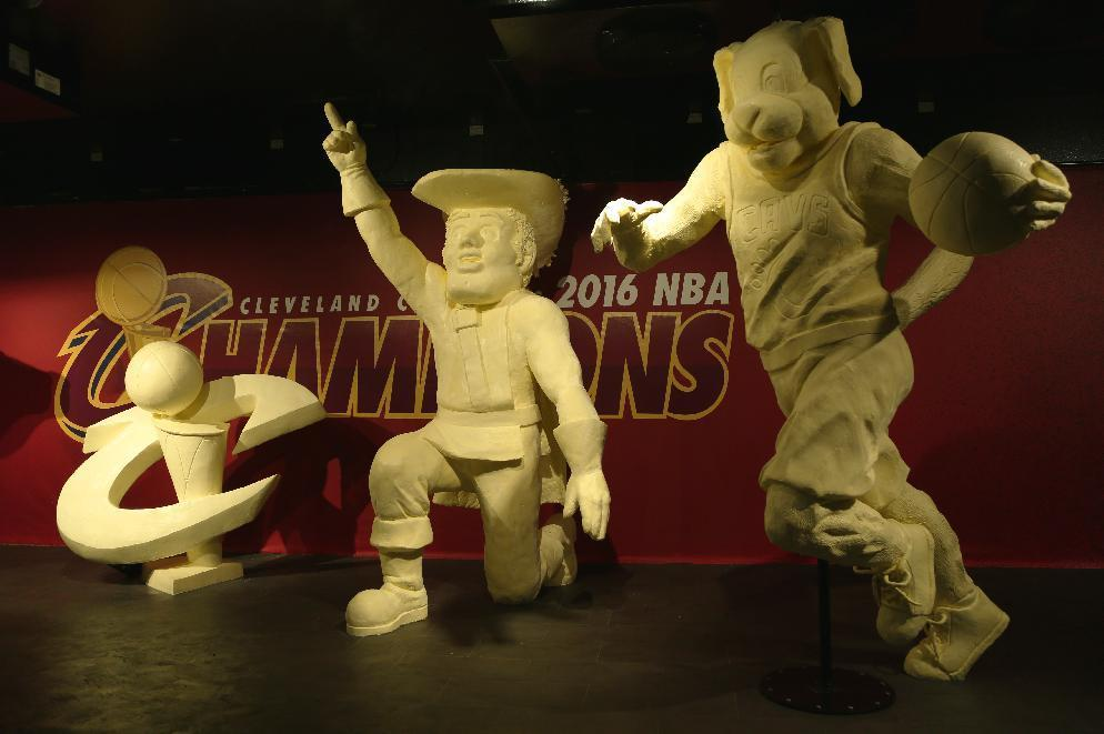 This July 18, 2016 photo, provided by The American Dairy Association Mideast, shows some of the butter sculptures honoring the Cleveland Cavaliers' NBA basketball championship team at the Ohio State Fair in Columbus, Ohio. The fair opens Wednesday, July 27, 2016. (Jerred Ziegler/The American Dairy Association Mideast via AP)