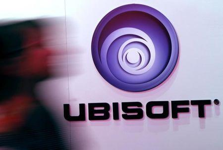 A man walks past a Ubisoft logo at the 2014 Electronic Entertainment Expo, known as E3, in Los Angeles