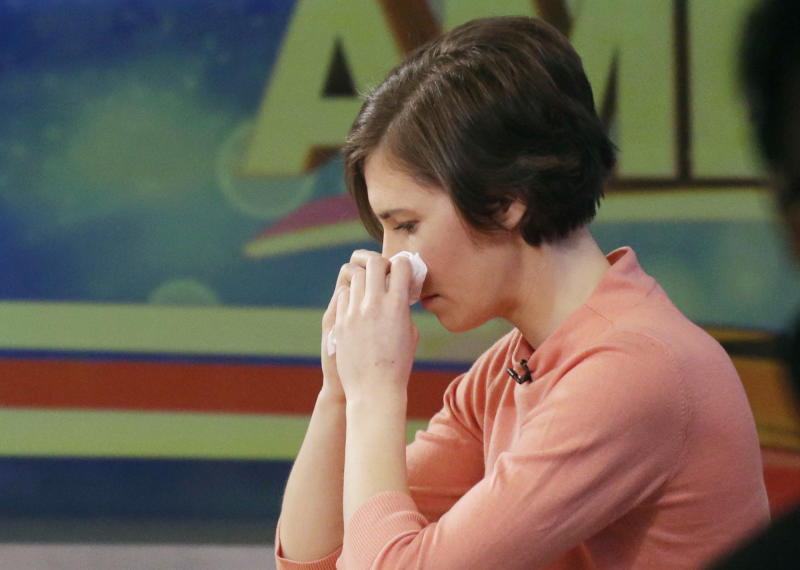 "Amanda Knox wipes her nose with a tissue while making a television appearance, Friday, Jan. 31, 2014 in New York. Knox said she will fight the reinstated guilty verdict against her and an ex-boyfriend in the 2007 slaying of a British roommate in Italy and vowed to ""never go willingly"" to face her fate in that country's judicial system . ""I'm going to fight this to the very end,"" she said in an interview with Robin Roberts on ABC's ""Good Morning America."" (AP Photo/Mark Lennihan)"