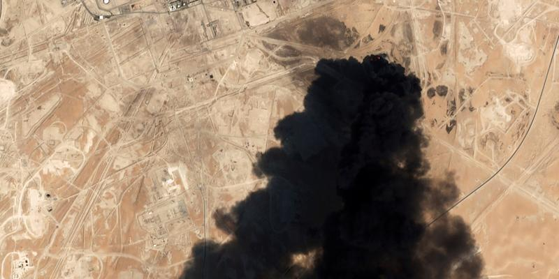 FILE - In this Saturday, Sept. 14, 2019 file photo, a satellite image from Planet Labs Inc. shows thick black smoke rising from Saudi Aramco's Abqaiq oil processing facility in Buqyaq, Saudi Arabia. The assault on the beating heart of Saudi Arabia's vast oil empire follows a new and dangerous pattern that's emerged across the Persian Gulf this summer of precise attacks that leave few obvious clues of who launched them. (Planet Labs Inc via AP, File)