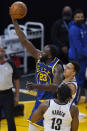 Golden State Warriors forward Draymond Green (23) shoots against Brooklyn Nets guard James Harden (13) and guard Landry Shamet during the first half of an NBA basketball game in San Francisco, Saturday, Feb. 13, 2021. (AP Photo/Jeff Chiu)