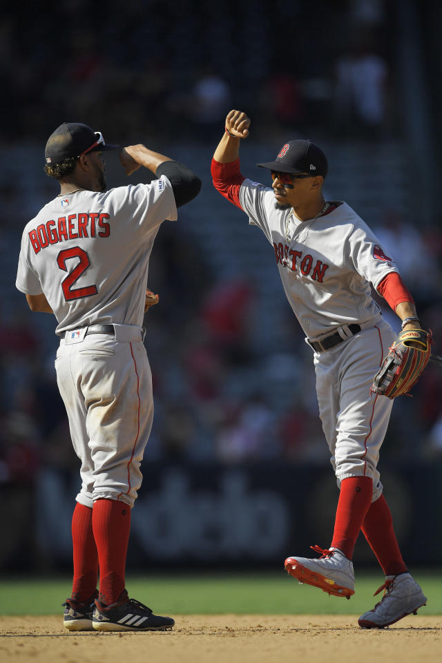 Boston Red Sox shortstop Xander Bogaerts, left, congratulates right fielder Mookie Betts after the Red Sox defeated the Los Angeles Angels 4-3 in a baseball game Sunday, Sept. 1, 2019, in Anaheim, Calif. (AP Photo/Mark J. Terrill)