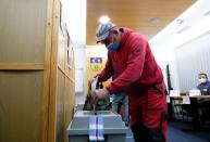 A person casts his ballot during the parliamentary elections in Lovosice