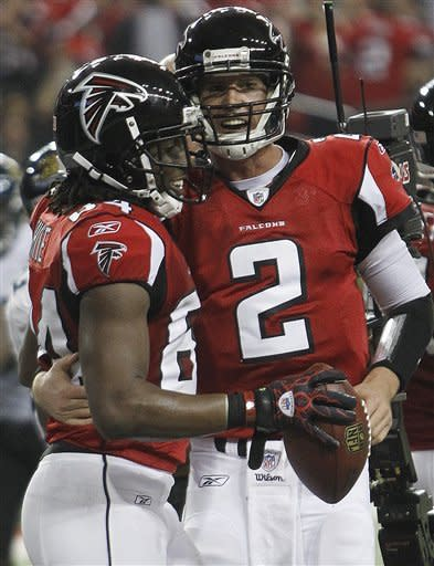 Atlanta Falcons quarterback Matt Ryan (2) celebrates Atlanta Falcons wide receiver Roddy White's touchdown during the first half of an NFL football game Thursday, Dec. 15, 2011, in Atlanta. The catch set a Falcons record for touchdowns by a QB/WR combination. It was their 33rd touchdown together. (AP Photo/John Bazemore)