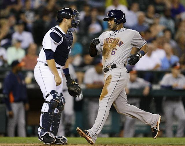 Houston Astros' Jonathan Villar, right, scores past Seattle Mariners catcher Mike Zunino in the third inning of a baseball game, Tuesday, Sept. 10, 2013 in Seattle. (AP Photo/Ted S. Warren)