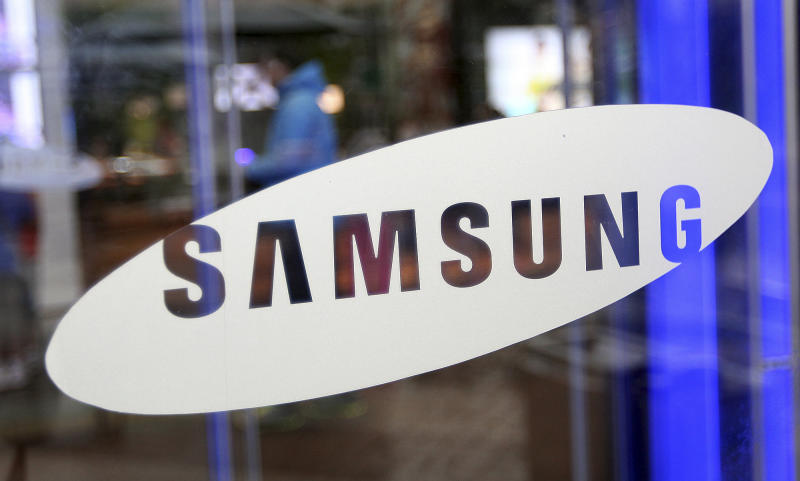 A man walks by the entrance to Samsung Electronics Co.'s showroom at its headquarters in Seoul, South Korea, Friday, July 6, 2012. Samsung, the world's largest maker of memory chips, mobile phones, flat-screen panels and televisions, said Friday that its preliminary second-quarter operating profit jumped nearly 80 percent from a year ago to a record high. (AP Photo/Hye Soo Nah)