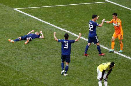Soccer Football - World Cup - Group H - Colombia vs Japan - Mordovia Arena, Saransk, Russia - June 19, 2018 Japan players celebrate after the match REUTERS/Damir Sagolj