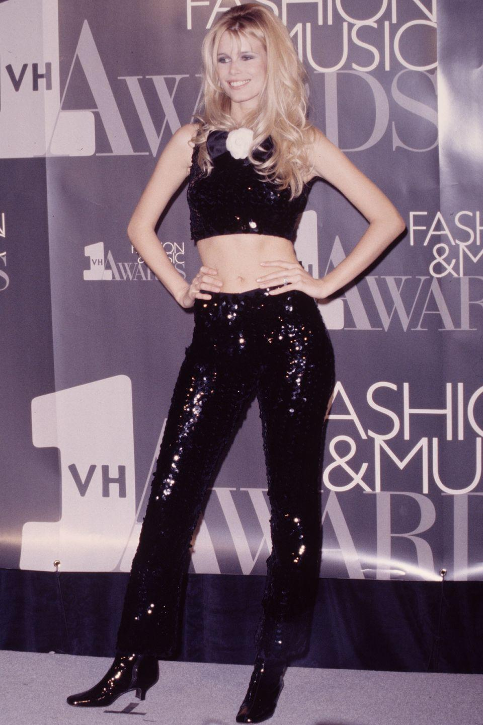 <p>At another Fashion Music Awards wearing skin-tight PVC jeans by Chanel and matching cropped top!</p>