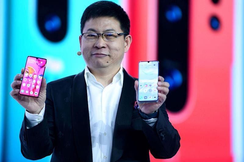 Huawei's head of consumer Richard Yu with the latest Huawei P30 Pro phones (ERIC PIERMONT / Contributor)