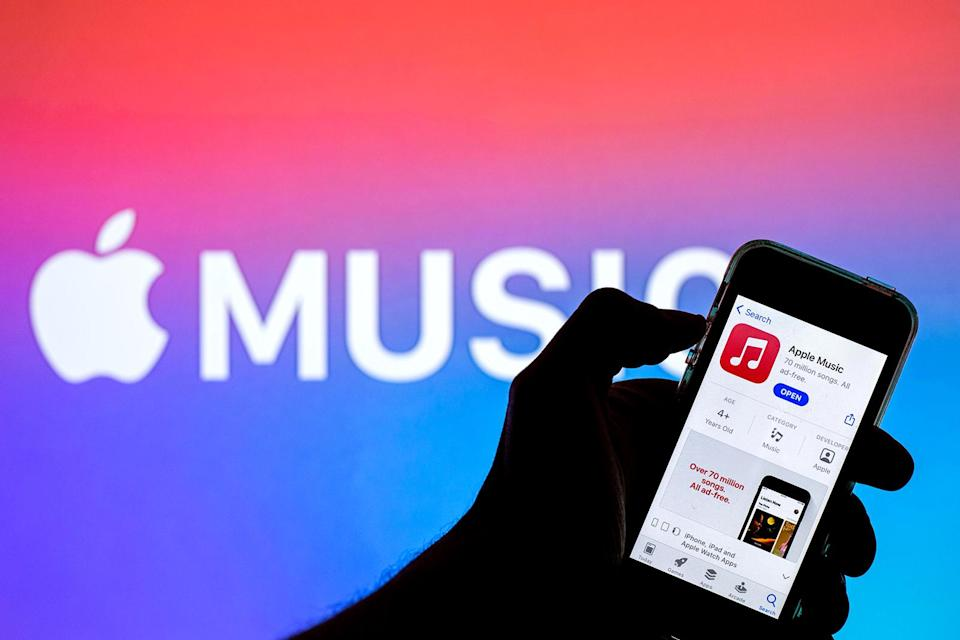 SPAIN - 2021/04/12: In this photo illustration an Apple Music app in App Store seen displayed on a smartphone with the Apple Music logo in the background. (Photo Illustration by Thiago Prudencio/SOPA Images/LightRocket via Getty Images)