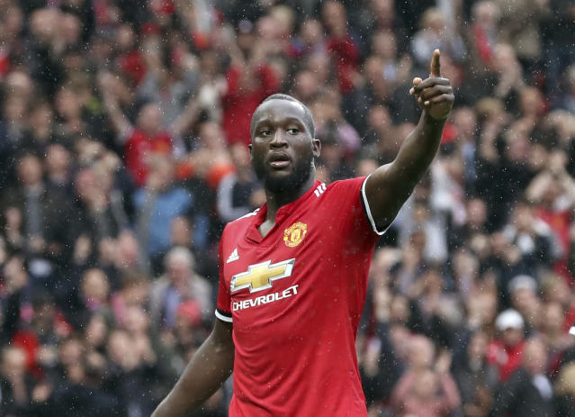 Manchester United's Romelu Lukaku, right, celebrates scoring his side's fourth goal of the game during the English Premier League soccer match between Manchester United and Crystal Palace