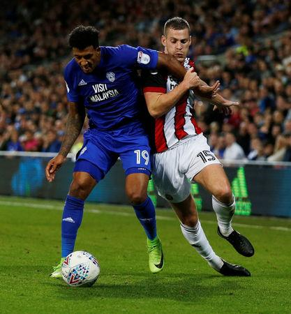 Soccer Football - Championship - Cardiff City vs Sheffield United - Cardiff, Britain - August 15, 2017   Cardiff City's Nathaniel Mendez Laing in action with Sheffield United's Paul Coutts   Action Images/Peter Cziborra