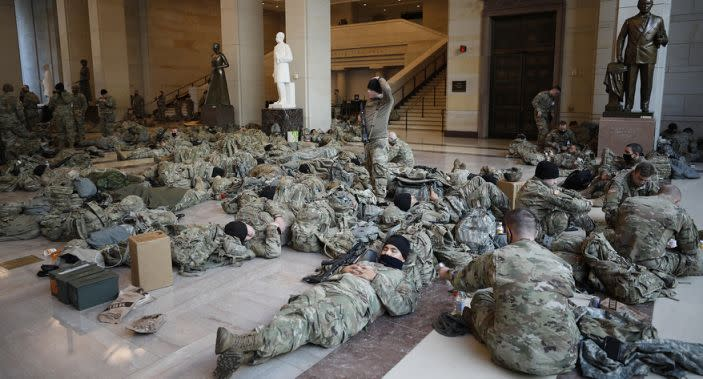 National Guard members lay on the floor of the US Capitol building.
